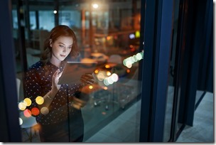 Cropped shot of a young businesswoman working late on a digital tablet in an office